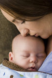 Mother and sleeping newborn Stock Photos