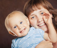 Mother with a small baby Stock Image