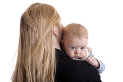 Mother with small baby boy on her shoulder Royalty Free Stock Photos