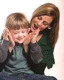 Mother and Small Boy Playing. Mother with preschool boy against white background playing Stock Photos