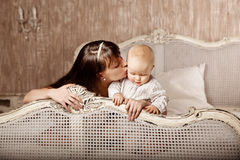 Mother with a small child in the interior. Smiling family in the Stock Images