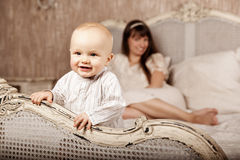 Mother with a small child in the interior. Smiling family in the Royalty Free Stock Photography