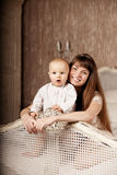 Mother with a small child in the interior. Smiling family in the Royalty Free Stock Photos