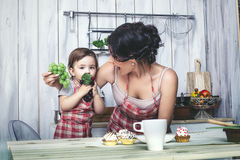 Mother and small child in the kitchen at home beautiful and happy royalty free stock photography