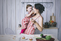 Mother and small child in the kitchen at home beautiful and happy stock photography
