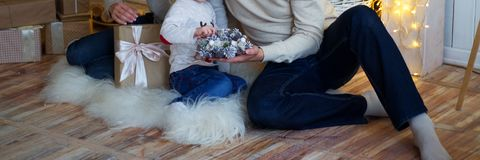 mother with a small child near the New Year tree. beside are gifts and a fireplace royalty free stock photos
