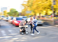 Mother with small child and a stroller Stock Photo