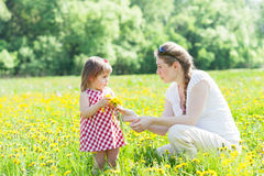 Mother with the small daughter Stock Images