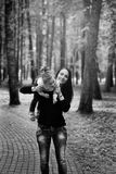 Mother and small daughter have fun in a park. Blck and white Royalty Free Stock Photo