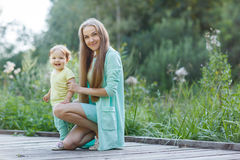 Mother with small daughter resting in park Stock Images