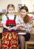 Mother and small daughter in Russian traditional sarafan Royalty Free Stock Photos