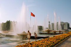 Mother and small girl walk under the fountain Royalty Free Stock Photo