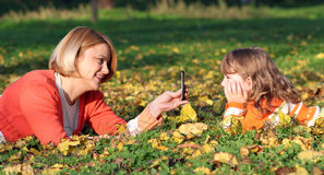 Mother with smartphone take picture Stock Image