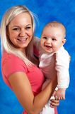 Mother smile to her child Stock Photography