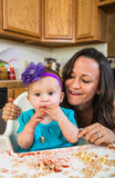 Mother Smiles With Baby Stock Photography