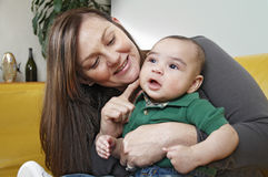 Mother smiling with her baby son Stock Image