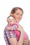 Mother Smiling Holding Baby Royalty Free Stock Images