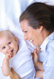 Mother and son. In bed having a good time Royalty Free Stock Images
