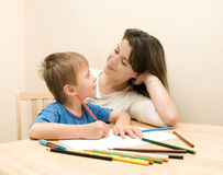 Mother and Son. Mother watching  her son drawing Stock Photos