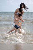Mother and son. Beach sunbathing Mother and son, laid-back holiday Stock Image