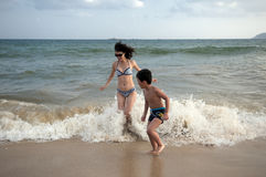 Mother and son. Beach sunbathing Mother and son, laid-back holiday Stock Photos
