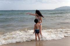 Mother and son. Beach sunbathing Mother and son, laid-back holiday Royalty Free Stock Images
