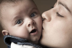 Mother and Son. Picture a little boy with his mother, which he tenderly kisses Royalty Free Stock Photo