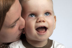 Mother and Son. Picture a little boy with his mother, which he tenderly kisses Stock Photography