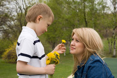 Mother and son. In his hand the boy flower dandelion Royalty Free Stock Photos