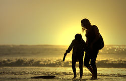 Mother and son. With bodyboard board Royalty Free Stock Photos