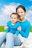 Mother and son. Happy family(Mother and son) in the grassland royalty free stock photography