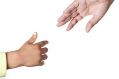 Mother and son. A child try to reach is mother hand on white background Stock Photos