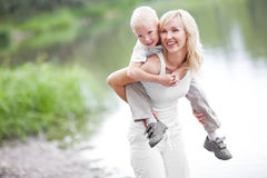 Mother and son. Happy  family; young mother and her five year old son spending time outdoor on a summer day Stock Images
