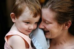 Mother and Son. Beautiful mother and cute little boy cuddling and playing together Royalty Free Stock Image