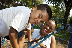 Mother and son. Playing at a park Royalty Free Stock Photo