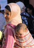 Mother and son. A Moroccan woman carries a baby on your back royalty free stock images