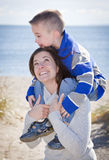 Mother and son. Mother giving son a shoulder ride at the beach Royalty Free Stock Photography
