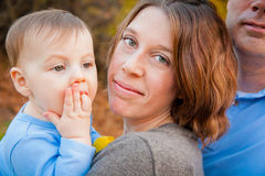 Mother and Son. A mother holding her young son outside. The image is horizontal Royalty Free Stock Images