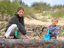 Mother with son. Play on beach Royalty Free Stock Photography