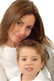 Mother and son. Attractive young mother holding her toddler son and smiling Stock Photos