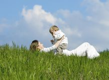 Mother and son. Mother and son play on the lawn Stock Images