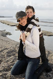 Mother and son. Beautiful mother in her son's loving embrace on the beach Stock Photography