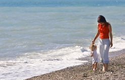 Mother and son. Walking on beach Royalty Free Stock Photos