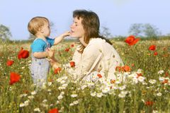 Mother and son. Playing in flowers Stock Photos