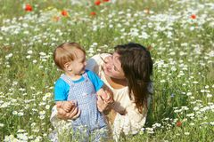 Mother and son. In flowers Royalty Free Stock Image