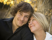Mother & Son. Portrait of a mother and her son. Mom is looking at her son, he's smiling at the camera Stock Photos