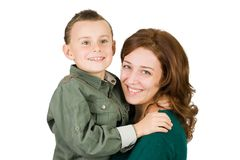 Mother and son. Mother holding her cute seven year old son, isolated on white Royalty Free Stock Photo