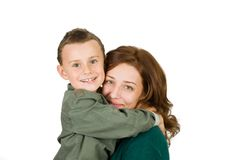 Mother and son. Mother holding her cute seven year old son, isolated on white Stock Photography