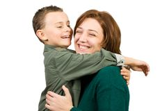 Mother and son. Mother holding her cute seven year old son, isolated on white Royalty Free Stock Image