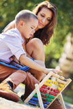 Mother son abacus Stock Image